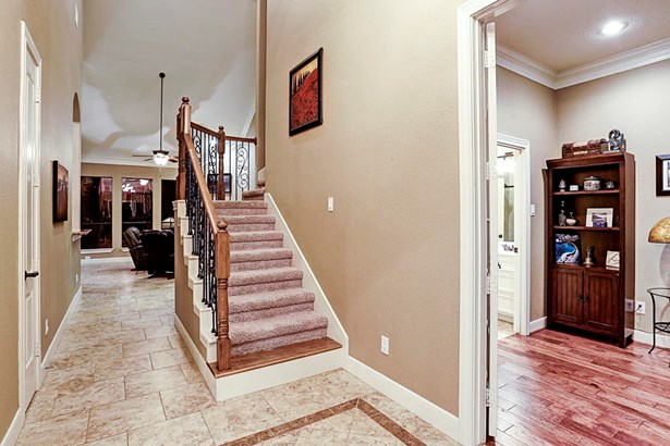Upon entering the front door the high ceilings, dazzling tile and wood floors welcome guests. (photo 2)
