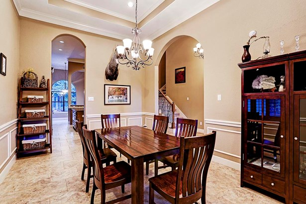 The grandiose dining room is adjacent to the foyer and open kitchen. (photo 4)