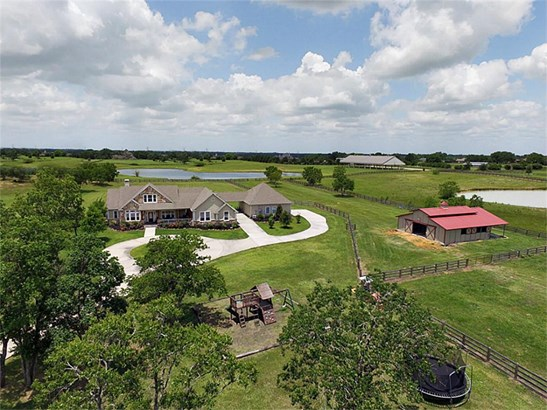 This exceptional property is located on over 10 acres of land and is a horse lovers dream. The property is conveniently located close to shopping, hospitals, schools and a short distance to Hwy 290/HWY 99. (photo 1)