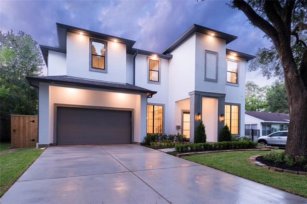 Welcome home to this gorgeous property perfectly located in the desirable Oak Forest! The exterior of this home features wide driveway, stained garage door, hand-scraped stucco accents, ambient lighting and mature oak trees.