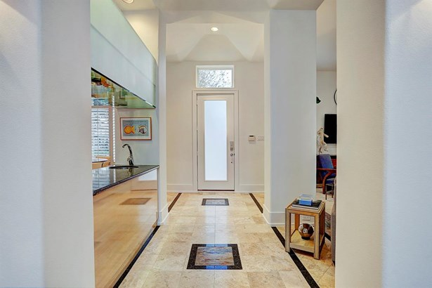 Beautiful entry with privacy front door, marble flooring, high ceilings...service bar on left for entertaining (photo 5)