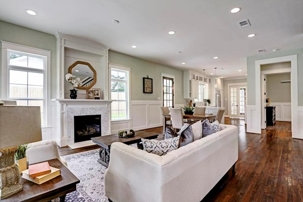 Living Room with cozy gas fireplace with custom carpentry and marble surround mantle (photo 5)