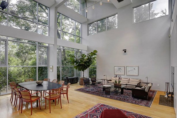 Open concept Living Room and Dining Room, with 26ft ceiling high and walls of windows. (photo 5)