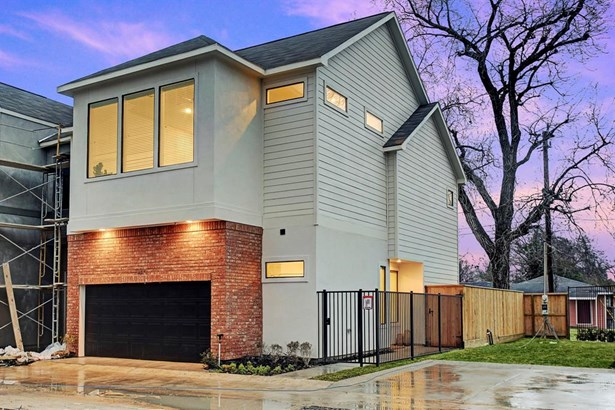 Photo of a similar completed home in another community completed by City Choice Homes. A closer approach of the homes entry, residents and guests are welcome by a solid wooden door with glass casement and dual double pane low-E windows illuminated the ent (photo 4)
