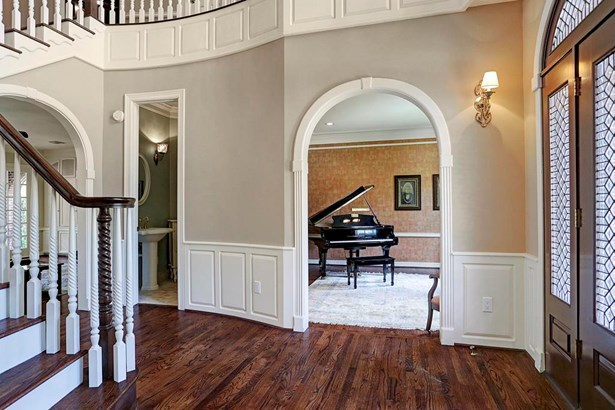 The foyer opens up to the entire house. It leads upstairs, into the formal living room, dining room and family room! (photo 2)
