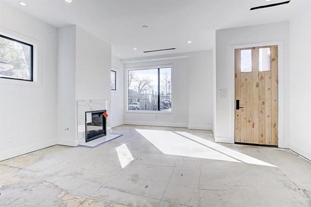 First floor open living features include gas jet fireplace, hardwood floors... (photo 3)