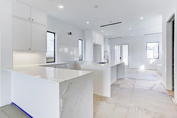 Simplicity and elegance abound in the Kitchen from the quartz counters to the custom cabinetry. (photo 5)
