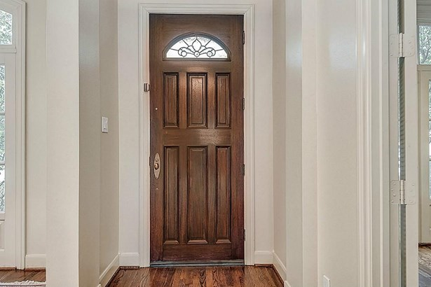 Beautiful entry door with formal dining on one side & office/formal living across. (photo 3)