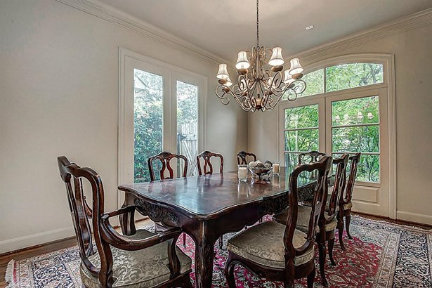 Large dining room has been freshly painted. Pretty windows and two built-in buffet cabinets w/serving counters. (photo 4)