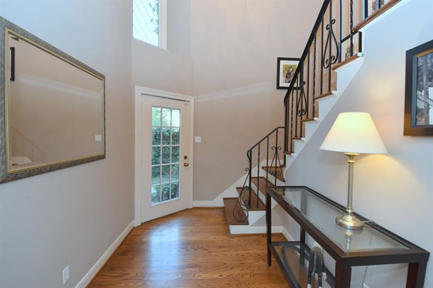 2-Story entry with lots of natural light coming in from the front door and the clerestory window above! Beautiful wrought iron stair balustrade befitting the style of home. Hardwood Flooring, hardwood treads and painted risers on stairs. (photo 3)