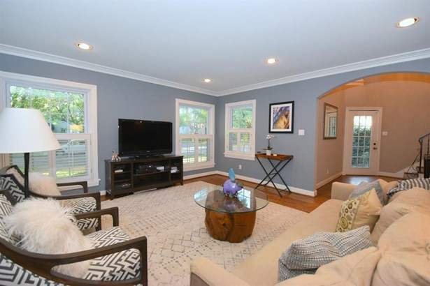 Huge Living Room - Very light and open with many cafe shuttered windows. Wide Plank Hardwood Flooring, well- placed recessed lighting - with view of entry. (photo 4)