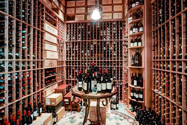 Adjacent to the dining room is a temperature controlled wine cellar designed to hold approximately 2,400 bottles. (photo 5)
