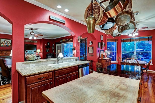 The open kitchen includes an extensive island with a half Vermont soap stone and half maple butcher s block. (photo 4)