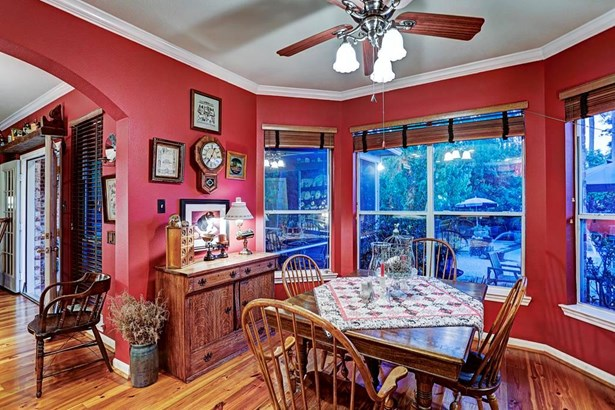The oversized breakfast room nook has a lovely view of the backyard and pool through the large bay window. (photo 5)