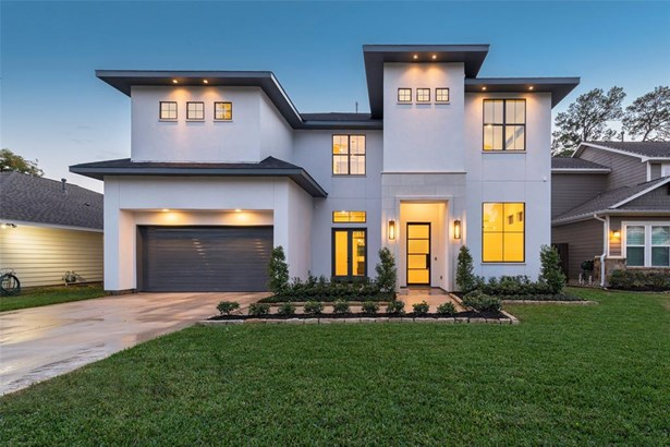Welcome home to this beautiful soft contemporary home by SF Custom homes. Exterior features lush landscaping, stucco and cast stone facade, as well as iron front door. (photo 1)