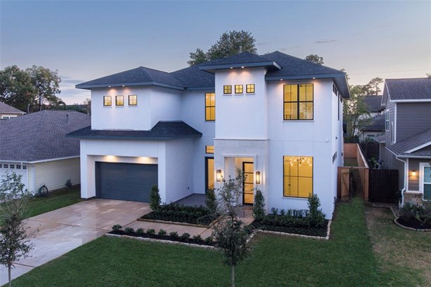 Another view of this magnificent property. This property boasts extra large windows and designer light fixtures and extra lighting along the roof line. (photo 2)