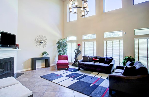 Spacious open family room with large windows providing natural light. (photo 5)