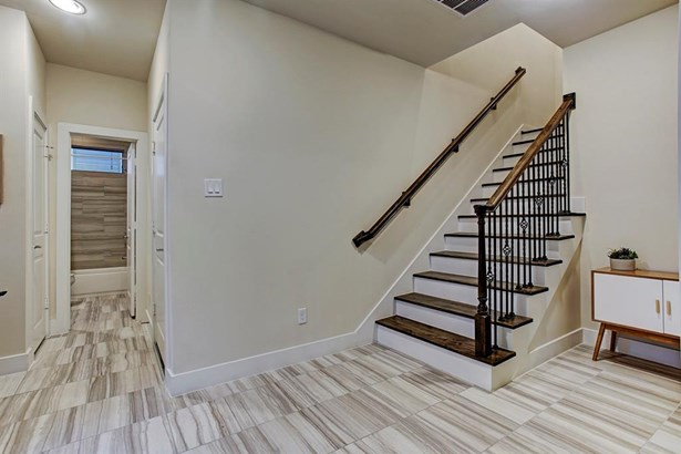 Photo of a similar completed home by City Choice Homes. Ultra wide foyer warmly greets guests. Front door with dividing windows allows for plentiful natural light. Iron & wooden balustrade lead you to the 2nd level. (photo 5)