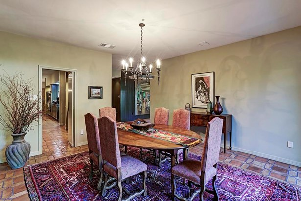 Located just off the foyer and the kitchen is the dining room, perfect for hosting family gatherings. (photo 2)