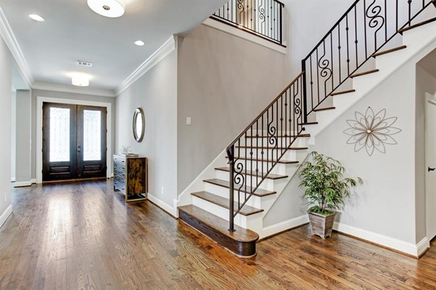 Spectacular Foyer, with sweeping staircase. Opens to a Study, Formal Dining room and large Kitchen/Living space. (photo 3)