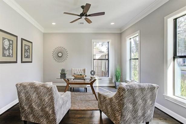The study, just off the main entryway. Abundant natural light, warm hardwood floors and custom molding. (photo 4)