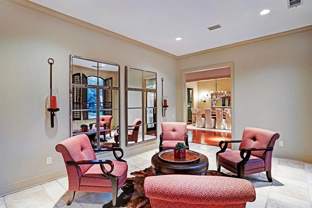 Entertain all of your guests in this formal living room that is directly across from the formal dining room. (photo 4)