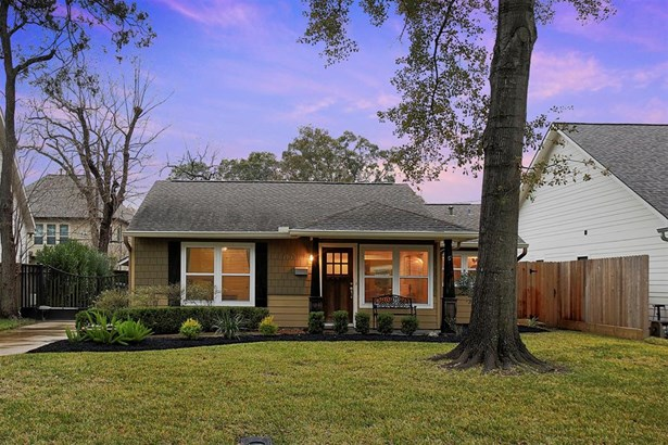 Charming, traditional single family home is situation on a large lot with mature trees. (photo 2)