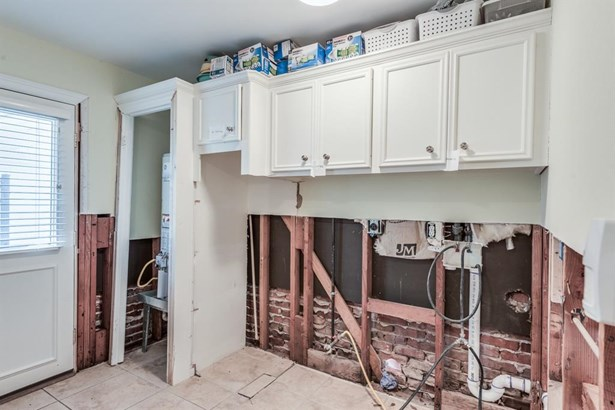In-house utility room with great upper storage and full-size capacity for washer & dryer. (photo 4)