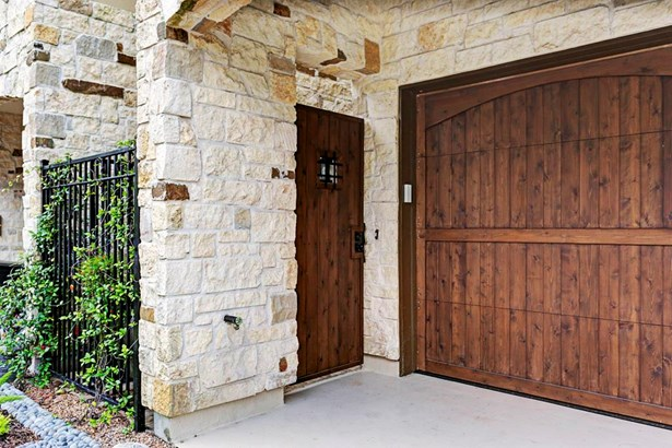 Beautiful stone and wood entry from private driveway. Ample parking for several cars and rear alley access. (photo 2)