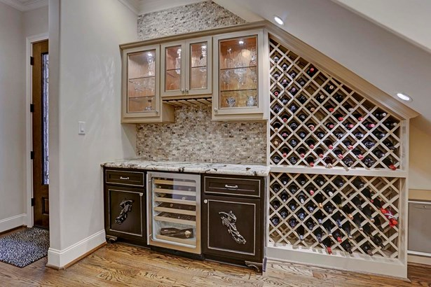Wine grotto near the entry is a custom feature that was designed by the seller and makes this home wonderful for entertaining. (photo 3)