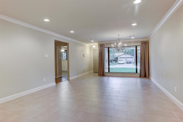 Upon entry guests are welcomed into a dining and formal living area featuring a large picture window, tile flooring, recessed lights and crystal chandelier. (photo 3)