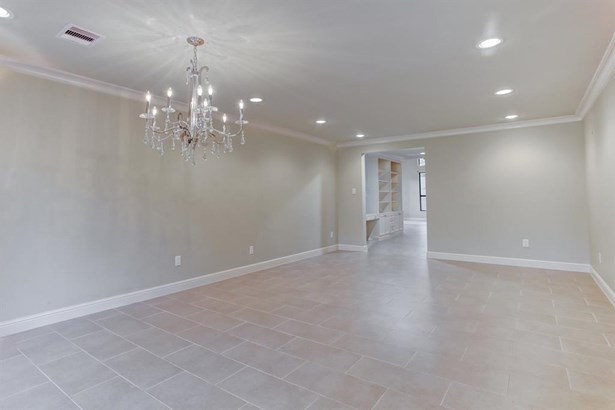 Additional view of the formal dining and living room with recessed lighting, neutral 12x24 tile floors laid on a broken joint. This home was taken down to the studs and completely renovated replacing all major mechanicals. (photo 4)