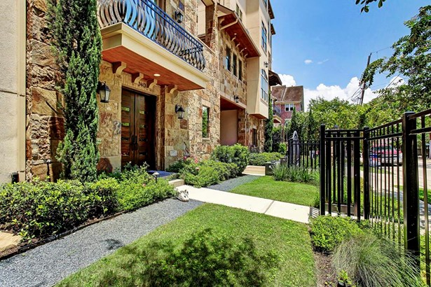 There is private street access to the home. The low maintenance landscaping and lush plants surrounding the entry welcome guests to this immaculate home. (photo 2)