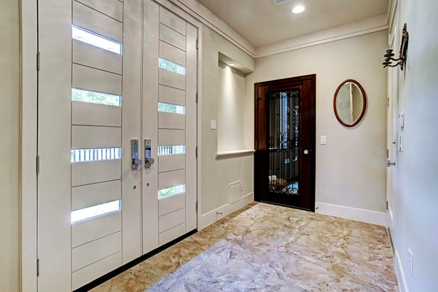 Upon entering the home through the double doors, you will notice the sleek design carried throughout the home. There is a wine room on the first floor as well as a storage closet and elevator to all floors. (photo 3)