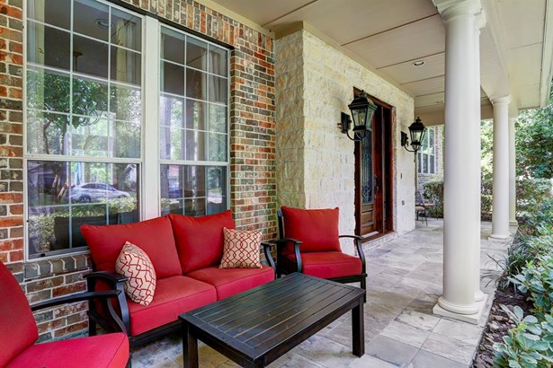 Enjoy your evening on the front patio where texas limestone and gas lamps adorn the entry. (photo 3)