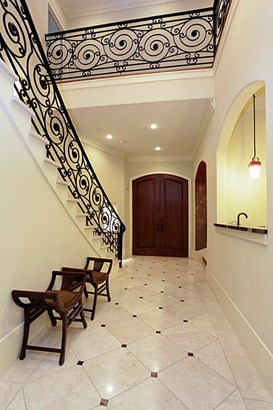 Elegant travertine entry with double wood custom doors and opening to the dining room and bar on the right. (photo 2)