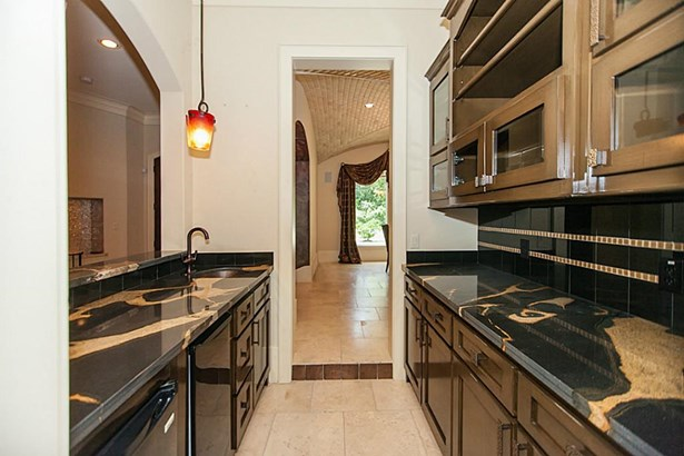 Great bar with sink and gorgeous counters .great upper and lower storage, located just off the entry and accessible to the dining room and kitchen. (photo 5)