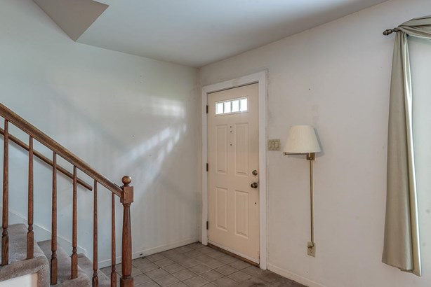 The entry area has tile flooring and opens to the living and dining areas. (photo 3)