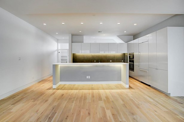 The kitchen features silestone counters and on site built modern finishing (photo 3)