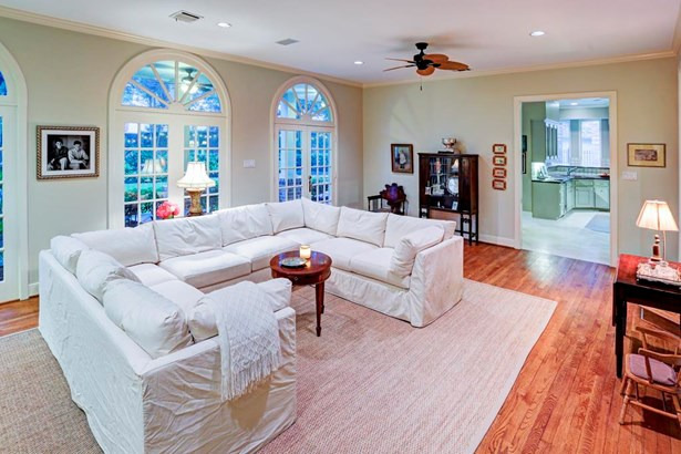 Family Room (26x14) with three arched transom windows overlooking backyard and covered patio.Provides tremendous natural light. Masonry bricked gas/wood burning fireplace, and hardwood flooring.Speaker system in this room and outdoor patio. (photo 4)
