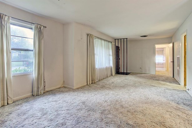 Large formal living room can be transformed into a formal living/foyer and study. (photo 3)
