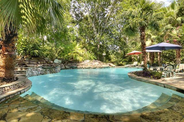 This incredible pool with decking and water feature mimics the most discerning boutique resorts. A fabulous venue for entertaining! (photo 3)