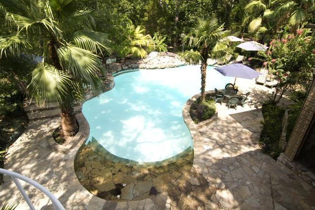 This view of the beautiful pool was taken from an upstairs balcony - a serene and beautiful sight. (photo 4)