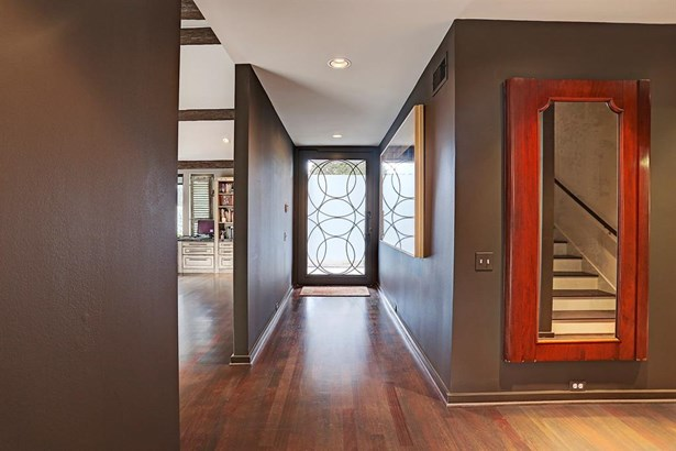 The front foyer. The cherry-stained ebony wood floors throughout the downstairs living areas were redone in November 2017. (photo 2)