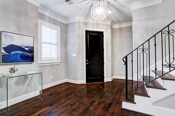 Gracious entry of this 4 bedroom, three story home with elevator installed. (photo 2)