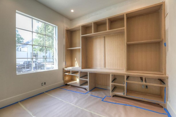"""Spacious study with site built-in maple cabinets and 9 arched southern exposure window that floods the room with natural light. Beveled 5"""" European White Oak planks throughout. 11 ceiling height. Construction as of 8/21/17 (photo 3)"""