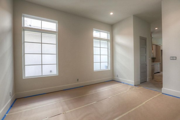 From the foyer, enter the elegant dining room with access to kitchen, wet bar, and custom pantry. Large western facing windows, White Oak flooring and crown molding complete this room. Construction as of 8/21/17 (photo 4)