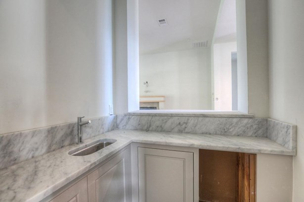 Centrally located wet bar features a marble serving counter, large opening great room, wine fridge and custom cabinetry. Inlaid honed Limestone flooring ties the space together. Construction as of 6/10/17 (photo 5)