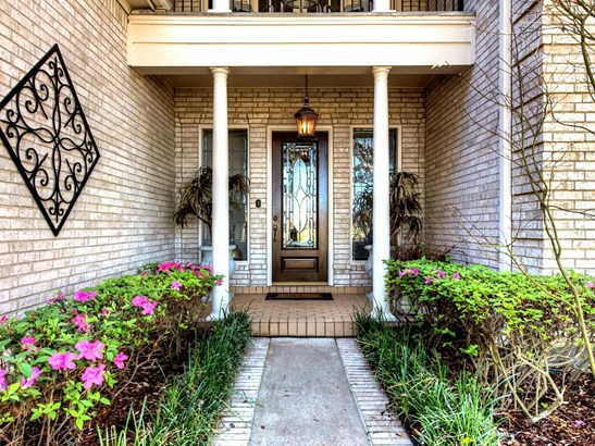 Landscaped front walk leads to a covered front entrance and a beautiful wood & leaded glass front door which opens to a most handsome and well-maintained home. (photo 2)