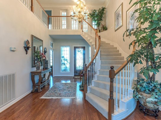 Impressive 2-story entry with winding staircase and gorgeous wood flooring opens to a formal study on the left with leaded glass transom above the doorway. Formal living and dining rooms are straight head. (photo 3)